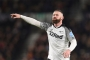 Rooney ends playing career to become full-time Derby boss