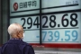 Asian shares sink after tech rout pulls Nasdaq 3.5% lower