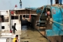 Ferry tilts with vehicles at Paturia ghat